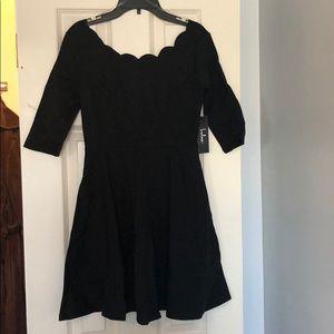 Scallop neck dress.